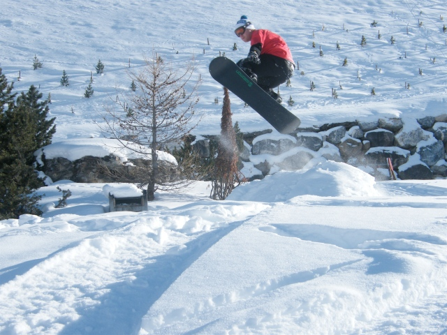 The author snowboarding